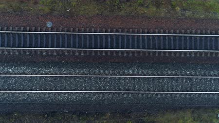 macadam : Empty double track railway in a top view.