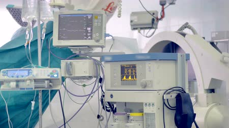 vital signs : A set of medical equipment showing patients vitals and an IV bag. 4K.