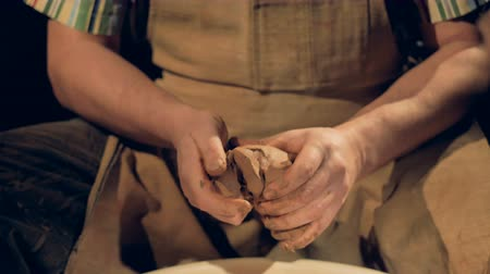 fingertips : Strong potters hands knead a piece of clay. Stock Footage