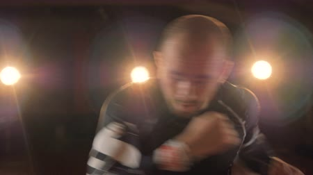 avoiding : A close-up on a fighter punching air and avoiding hits. Stock Footage