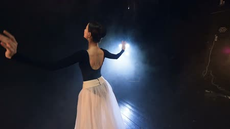 classical suit : A dancer turns around wearing a backless leotard.