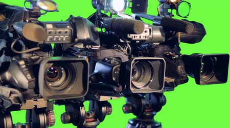 tenso : Row professional video cameras on tripods.