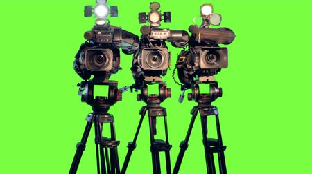 tenso : Professional broadcast studio video cameras on green screen.