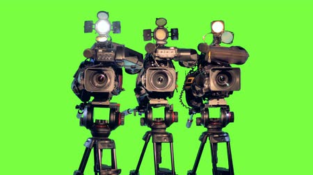 tenso : Three professional video cameras camcoders on tripods.
