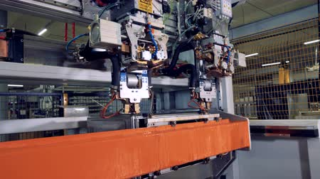 lower part : A side view on a robotic steel processing machine with changing tool heads. Stock Footage
