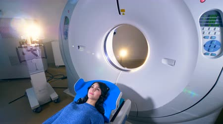 tomograph : Woman on a magnetic resonance imaging MRI scan in a modern hospital. Stock Footage