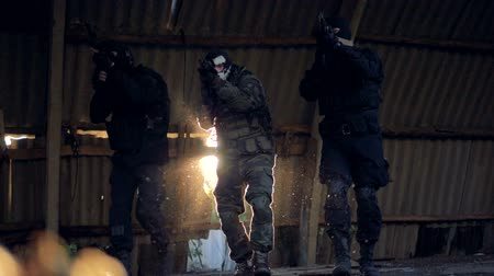 riot : A SWAT team scans the building ruins in search of enemy. Stock Footage