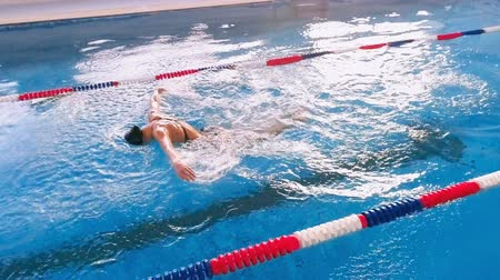 inhaling : Professional swimmer training in pool. Slow motion.