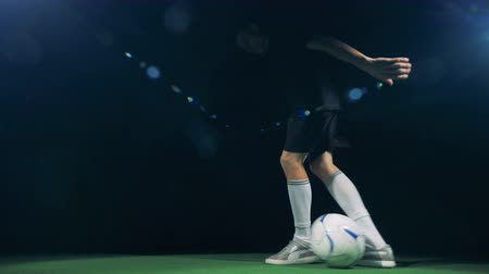into the camera : Professional soccer player is rushing into the picture, getting the ball and making tricks.