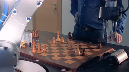 humanoid : Innovative robotic chess artificial intelligence play chess with a human.