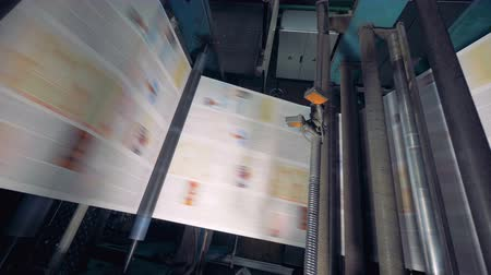 nakladatelství : Newspaper printing by printing press at printing house.