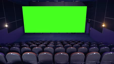 resimlerinde : Big chroma key screen in the cinema hall.