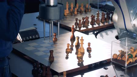 the conception : The process of game between chess player and robot. Stock Footage