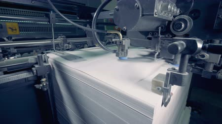 papyrus : Industrial mechanism is moving paper sheets on a high speed.