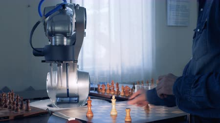 the conception : Robot and a chess player playing chess.