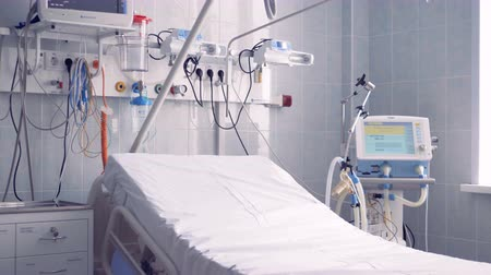 saline drip : Closer view of a part of a hospital ward where the bed and other equipment are located