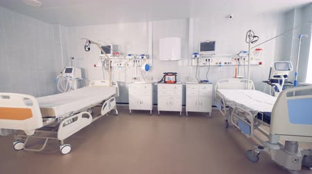 furnishing : Fully-equipped spacious hospital ward with two empty beds Stock Footage