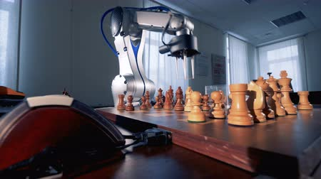 the conception : Chess game between a human and a artificial intelligence.