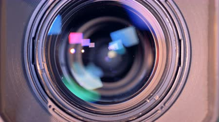 tv channel : Internal objective lens of a video camera is zooming in Stock Footage