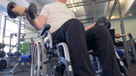 paralympics : Close-up view of dumbbells in disabled mans hands. Stock Footage