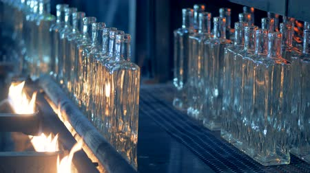 fire facilities : Glass bottles are moving along the automated conveyor belt and getting burnt. Stock Footage