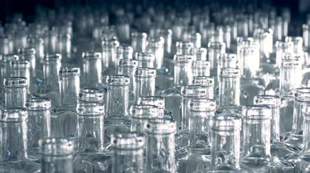 unfilled : Plenty of glass bottles are moving forward placed very closely to each other Stock Footage