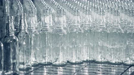 unfilled : Plenty of empty glass translucent bottles are getting stacked together