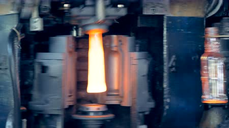 fire facilities : Industrial furnace is making and releasing glassy bottles
