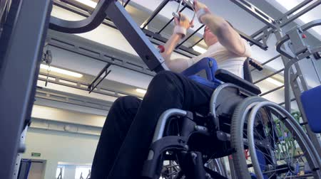 paralympics : Disabled man makes the thrust of the upper block for back. Stock Footage