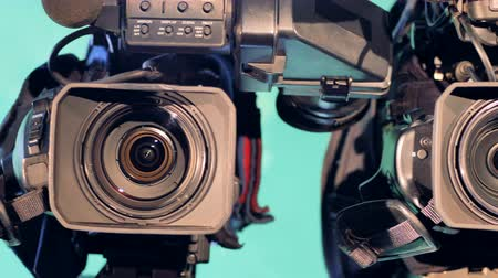 cinematography : Sequential close up of three video cameras lenses