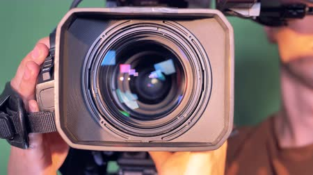filmagens : Operator is holding a video camera, turning it thereafter it is zooming out Stock Footage