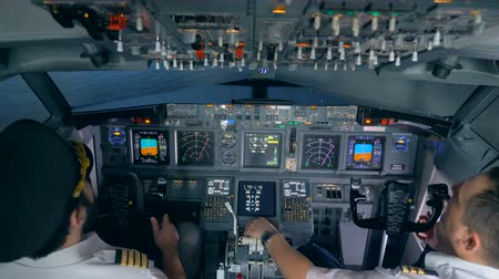 pilot in command : Pilots sit in a flight simuator, close up. Stock Footage