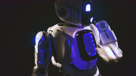 futuristický : A robot makes dancing movements with its arms in front of a camera, close up. 4K.