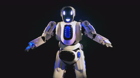multifunctional : White android looks at camera and dances. 4K. Stock Footage