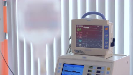 reanimation : Medical monitor showing vital rates of a patient Stock Footage