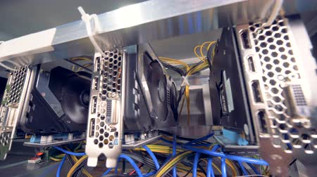 gaining : Functioning machines for bitcoin mining located in a mining rig Stock Footage