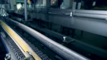 crate : Empty bottles move on two assembly lines, close up. Stock Footage