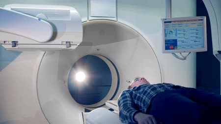 tomograph : A man in a tomographic scanner, close up. Stock Footage