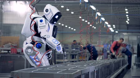installer : Human like robot works at a factory, using a special tool. Stock Footage