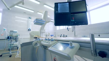 surgery theatre : Heart monitors placed above an operating table in an operating room at a hospital. 4K.