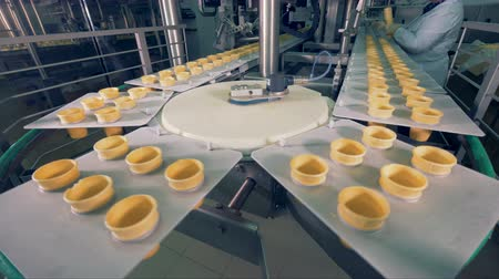 unfilled : Plates with inserted empty wafer cups are moving in an arc. 4K. Stock Footage