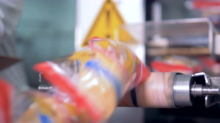 labeled : Packed wafer ice-cream cups are falling from the conveyor belt Stock Footage