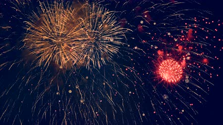 firecracker : Red firework bursts. Big firecracker bursts in the sky during celebration. Stock Footage