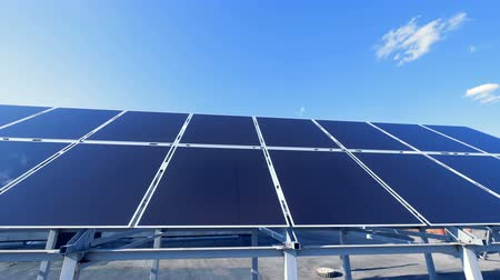 панель : Many solar panels on a roof. Big sun panels collect sunlight to convert it into energy.