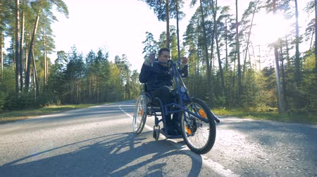 paralympics : One man rides a special bicycle for disabled people.