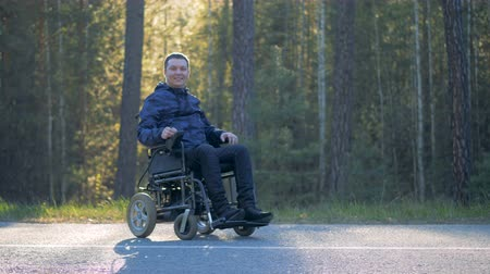 paralympics : A happy patient rests in a forest.