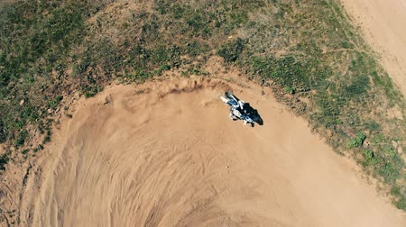 enduro : Sportsman rides a motorcycle, top view.
