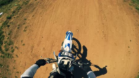 dirtbike : Biker on a motorcycle, first person view.