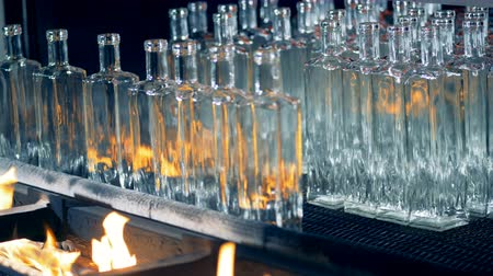 fire facilities : Glass bottles are getting burned and removed from the conveyor belt Stock Footage