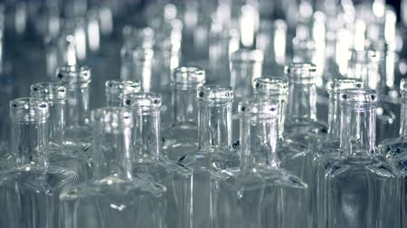 unfilled : A pile of empty glass bottles is moving forwards and sideways Stock Footage